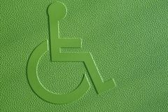 Disabled symbol on a green textured background. Royalty Free Stock Image