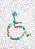 Disabled symbol put of pills and drugs Royalty Free Stock Photos
