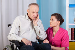 Disabled talking with a nurse and grieves royalty free stock photo