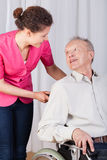 Disabled talking with a nurse Stock Images