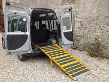 Disabled Taxi. A wheelchair friendly taxi showing the ramp for loading the chair. The cab also offers easy access too, for those with mobility difficulties Stock Photos