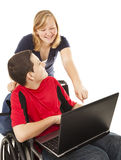 Disabled Teen And Friend On Computer Stock Photos