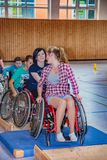 Disabled teenagers in wheelchair sports in the sports hall royalty free stock photos