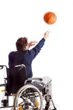 Disabled throwing basketball Stock Images