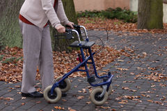 Disabled walking with walker outdoors Stock Photo