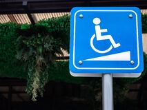 Free Disabled Way Sign. Wheelchair Symbol On Blue Sign Disabled Sign For Support Wheelchair Disabled People Royalty Free Stock Photo - 187832855