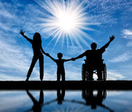 Disabled in wheelchair and family happy with their reflection Royalty Free Stock Photography
