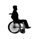 Disabled wheelchair silhouette. Man sits in carriage with wheels Stock Photography