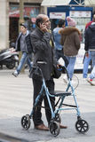 Disabled with wheelchair and standing with cellphone. Barcelona, Spain Royalty Free Stock Photography