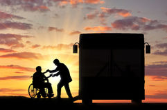 Disabled in wheelchair to help to come in bus Royalty Free Stock Photo