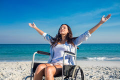 Disabled woman with arms outstretched at the beach Stock Images