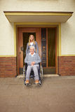 Disabled woman in assisted living. Happy disabled woman in wheelchair in assisted living stock image