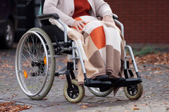 Disabled woman with blanket Royalty Free Stock Photography