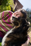 Disabled woman cuddles a dog. Mentally disabled woman cuddles a dog Stock Images