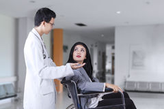 Disabled woman and doctor talking in the hospital Royalty Free Stock Photo