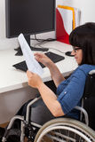 Disabled woman with documents. In the office Royalty Free Stock Photography