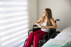 Disabled woman drinking some coffee Stock Photography