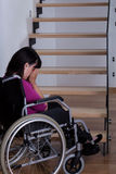 Disabled woman in front of stairs Stock Image