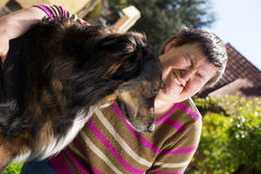 Disabled woman and an half breed dog. Disabled woman sitting outdoors with an half breed dog Royalty Free Stock Images