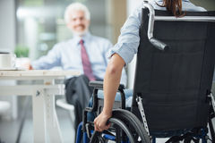 Disabled woman having a business meeting royalty free stock photo