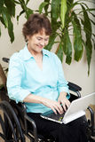 Disabled Woman with Laptop Stock Photo