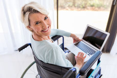 Disabled woman laptop computer Stock Photography