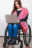 Disabled woman with laptop Stock Image