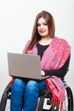 Disabled woman with laptop on wheelchair. Royalty Free Stock Photos