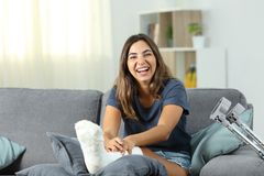 Disabled woman laughing looking at you. Sitting on a couch in the living room at home Royalty Free Stock Photography