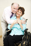 Disabled Woman and Loving Husband Royalty Free Stock Photography