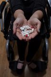 Disabled woman with medicines for depression Royalty Free Stock Image