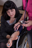 Disabled woman during pressure measurement. With nurse stock photography