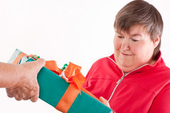 Disabled woman receives gift from senior Stock Image