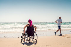 Disabled woman and running man Royalty Free Stock Photos