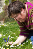 Disabled woman sitting on a meadow Royalty Free Stock Photography