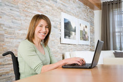 Disabled woman telecommuting. Disabled women telecommuting royalty free stock image