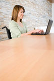 Disabled woman telecommuting Royalty Free Stock Image