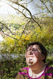 Disabled woman under a plum tree Royalty Free Stock Images