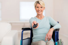 Disabled woman watching movies Royalty Free Stock Images