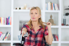 Disabled woman watching tv in living room at home. Disabled woman watching tv in the living room at home Stock Photo