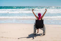 Disabled woman in the wheelchair. At the beach Royalty Free Stock Images