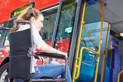 Disabled Woman In Wheelchair Boarding Bus Royalty Free Stock Image