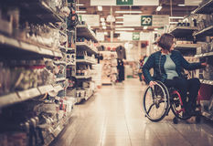 Disabled woman in a wheelchair in a department store Stock Photography