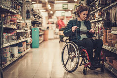 Disabled woman in a wheelchair in a department store Stock Images