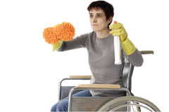 Disabled woman in wheelchair doing cleaning Royalty Free Stock Photo