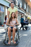 Disabled woman in wheelchair Royalty Free Stock Photos