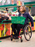 Disabled woman in a wheelchair in a store.  Stock Photography