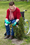 Disabled working in a garden Stock Photography