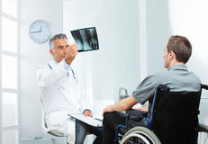 Disabled young man at doctor office Royalty Free Stock Photo