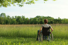 Disabled young man on the park Royalty Free Stock Image